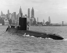 USS Nautilus (SSN-571) the world's first operational nuclear-powered submarine in New York Harbor.