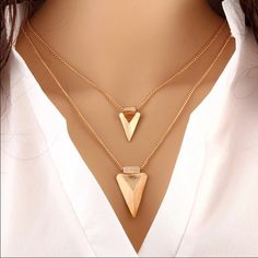 Double arrow head necklace Double arrowhead necklace. Gold in color. Jewelry Necklaces