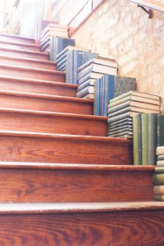 Stacks of books line the staircase of The Paris Market in Savannah, Georgia