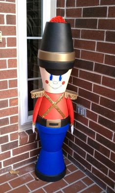 20 DIY Clay Pot Christmas Decorations That Add Charm To Your Holiday Décor Outdoor Clay Pot Nutcracker Clay Pot Projects, Clay Pot Crafts, Diy Clay, Holiday Crafts, Diy Crafts, Shell Crafts, Diy Projects, Clay Flower Pots, Flower Pot Crafts