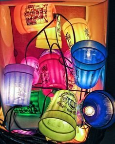 Eskimo Joe's cups re-purposed as backyard lights-Cool idea! On what to do with all those Joe's cups! :)