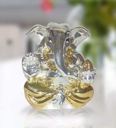 Appu Ganesha Two-Tone http://www.thedivineluxury.com/product/Appu-Ganesha-Two-Tone.html Golden and silver in color, Lord Ganesha idol looks elegant.