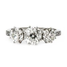 Bedford is a stunning vintage-inspired three stone engagement from Trumpet & Horn! // $13,800