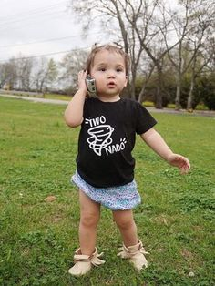 This toddler is telling us all about her day while sporting her Two Nado shirt. trendy kids clothes, cute toddler shirts, trendy toddler shirts, cute toddler, shirts, boy fashion, boy, girl fashion, girl, retro style, kids shirts, spring fashion, summer fashion, play clothes, stylish kids, stylish toddler, stylish boy, stylish girl,