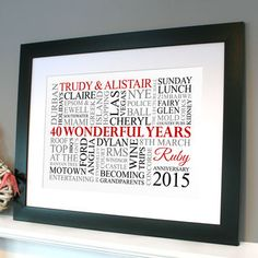 black framed print in white with red, black & grey text