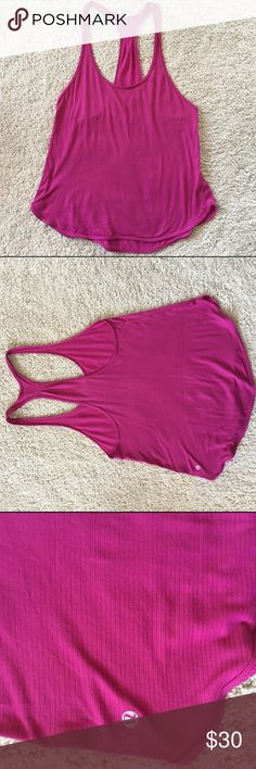 Lululemon 105f Singlet 6 Lululemon 105f singlet no longer sold in stores. Size 6. Too big on me, need a size 4. Dark pink raspberry color. Great condition. Smoke free home. Cheaper on Ⓜ️ercari lululemon athletica Tops Tank Tops