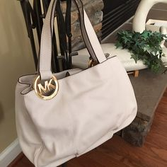 """Final price Pebbled vanilla leather gold accents Large tote shoulder handbag 9"""" drop down double straps with Gold tone signature rings bag measures 15.5"""" L x 11"""" H x 4.5 D.  Two side compartments divided by a middle zipped compartments with snap closures signature lining with one zip pocket & 4 slip pockets  Authentic 😀 great everyday bag very spacious Fulton MICHAEL Michael Kors Bags Totes"""