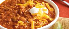 This hearty, spicy chili made with ground beef, beans, Muir Glen™ tomato and Progresso™ broth scores big as a game-day dinner. Replace the canned tomato sauce with thawed Make-Ahead Roasted Roma Tomato Sauce for an extra touch of homemade tomato taste.