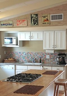 Clients went DIY to install a fun & funky Bottle Cap Backsplash - interior design by Patricia Lockwood http://lockwoodinteriors.net