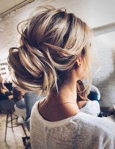 Updo wedding hairstyle inspiration | elegant chignon bridal hairstyle ideas.
