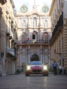 #Ferrari a passeggio nel centro storico di Trapani davanti al Palazzo Cavarretta. IL rumore del motore nel silenzio della città  www.bebtrapanigranveliero.it Rumore, Marsala, Sicily, Big Ben, Ferrari, Islands, Culture, Mansions, House Styles