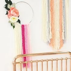 Darling DIY yarn art to create a gorgeous dreamcatcher for your nursery walls - seriously can't believe how easy these are to make with instructions