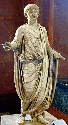 Statue of Nero As a child wearing a bulla.   Statue of Nero as a Child. 1978. Photograph. Vatican Museums, Rome. Vroma. Vroma. Web. 26 Sept. 2011. .