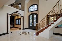 Notice how the design of this foyer ties the color of the front door into the space. This is always a good design idea.