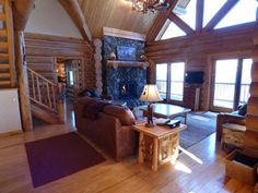 Leather furniture, beautiful fireplace, flat screen tv, and 2 sliding glass doors onto the wrap around deck.