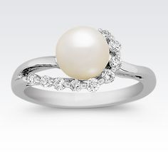 Regal and elegant, this unique 14 karat white gold ring features one 7-7.5mm cultured akoya pearl. This lustrous gem has exquisite color and sheen, which is further accentuated by a swirl of nine round diamonds, at approximately .19 carat total weight.