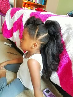 Long faux-hawk ponytails. Kid natural hair style.