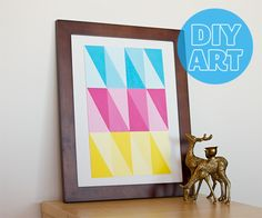 Geometric DIY. All you need is a blank canvas, 3 paint colours + white paint, a ruler and painter's tape!