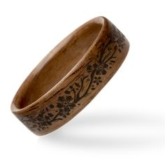 Looking to add a bit of a feminine flare to a natural ring? This vine pattern, burned into the wood with a laser, is the perfect option. Although the pattern is created with a laser, this ring is still 100% handmade. Our skilled artists craft the walnut base to your size, and the pattern is made to fit by our graphic design expert, all to give you the perfect ring. With our Care for Life and Perfect Fit guarantees, this ring can't get any better!