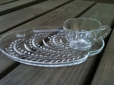 I am sure Mom had a set of these but will have to ask her or Diana about that.  If she did I'm not sure who has them now. set of 4 Federal glass snack plate and cup sets, etsy