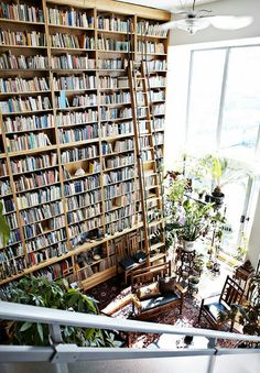 I want loads and loads of books in my book room because not only does it provide entertainment but it also adds to the aesthetics of the space. I also love the big glass windows and spots of greenery from the plants.