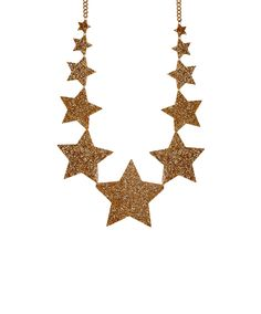 Shooting Star Large Necklace, Glitter Gold - Rival the night sky with the Shooting Star Large Necklace. Laser cut in glitter gold acrylic, graduating shooting stars are hand linked to a golden chain to create the perfect necklace for statement supernova style. Exclusive to Tatty Devine.