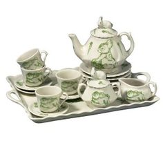 This porcelain tea set is beautifully decorated with green bunnies on every piece.  #easterbunny