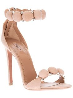 Beige suede high heel sandals from Alaïa featuring an open toe, with rounded suede motives with matte silver tone stud applications.