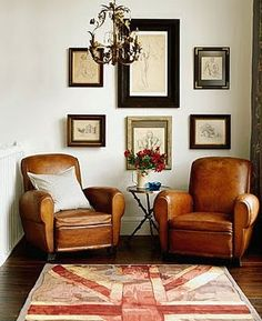 Two brown leather chairs.  I love brown leather chairs.  I could sit in one of…