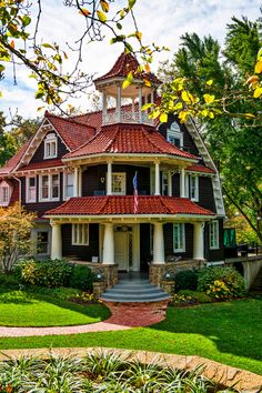 Victorian Home Exterior: Off-the-Chart Curb Appeal - Town & Country Living - - The Victorian home exterior is perhaps the most ornate and intricate. Common features include turrets, dormers, and wrap-around porches. Victorian Homes Exterior, Victorian Style Homes, Modern Farmhouse Exterior, Victorian Architecture, Victorian Cottage, Old Victorian Houses, Victorian House Plans, Town And Country, Country Living