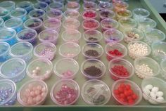 Bead Storage, using mini 2oz. condiments cups with lids....they are clear so you can see what's in them, and just pull the cups out you want to use. I organized by color....NoelsJewelryandMore.