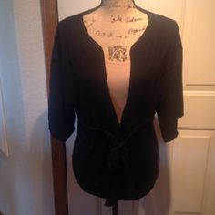 Ann Taylor Loft Black Cardigan Ann Taylor Loft large black cardigan with black beading and tie belt around the waist. Has two small hooks in the front to keep it closed. It's been worn several times but in great condition. Ann Taylor Sweaters Cardigans