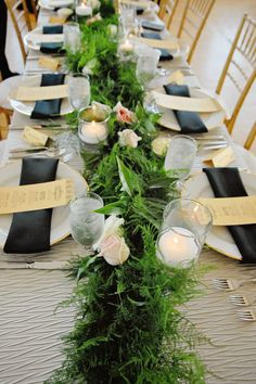 There's no need to drop a lot of dough on flowers—an inexpensive but lush runner of ferns and greenery looks just as fresh. Event design by La Cosa Bella Events; Photo by Pattie Mims.