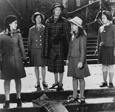 """Maggie Smith and Pamela Franklin (wearing glasses to the left of Smith) in """"The Prime of Miss Jean Brodie"""", 1969."""