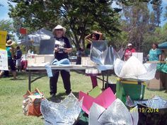 Sharon Clausson (inventor) with many of her Copenhagen Light solar panel cookers   Sacramento, CA SCI Festival, 19 July 2014