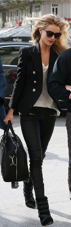 Rosie Huntington-Whiteley wearing a black leather handbag, zipper pants, blazer, and white tee