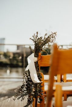 Tying greenery with ribbon on your ceremony chairs is a great minimal decor that still looks elegant! The Bridge Building provides an excellent space outdoors for this look too! Click the image to learn more about this Nashville wedding venue! Indoor Wedding Ceremonies, Wedding Ceremony, Nashville Wedding Venues, Restaurant Tables And Chairs, Aisle Markers, Infinity Wedding, Minimal Decor, Greenery, Bridge