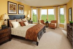 Master Bedroom Full of Natural Light Finished in a Warm Shade of Yellow