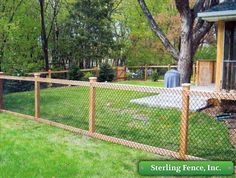 Chain link with wooden posts. Such an interesting look for a backyard fence and more affordable than an all wood fence. Love this combination of styles! Backyard Fences, Backyard Landscaping, Garden Fences, Outdoor Projects, Home Projects, Wooden Posts, My Pool, Dog Runs, Fence Design