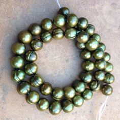 Round Green Freshwater Pearl Beads 16 inch by marketplacebeads, $15.00 Awesome bead shop ~ great prices! www.marketplacebeads.etsy.com