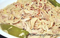 Ginataang Puso ng Saging Recipe - Ginataang Puso ng Saging are banana blossoms cooked in coconut milk. Try this delicious Filipino Recipe.