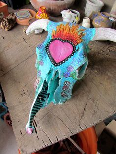 Day of dead sugar skull on real steer skull, handpainted to take advantage of bones' natural shape