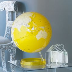 can paint an old globe with land one color and water another!
