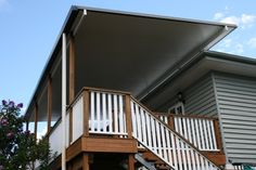 Timber Deck and Patio. Brisbane Deck builders Deking Pty Ltd. Timber Handrail, Timber Balustrade, Insulated Patio Roof forms part of the overall Deck Design. Pergola With Roof, Patio Roof, Backyard Patio, Patio Decks, Backyard Ideas, Timber Handrail, Timber Deck, Exterior Stairs, Exterior Doors