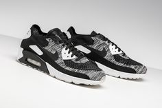 96cd8f10c7 A striking combination of black and white appears on this Nike Air Max 90  Ultra 2.0