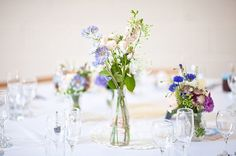 country flowers in milk bottles (rosie parsons photography)