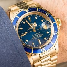 Excellent 1979 Vintage Rolex Submariner 1680 in 18k Gold with blue bezel and dial.