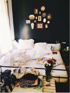 white curtains, white sheets - dark walls
