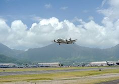 KANEOHE, Hawaii (July 14, 2012) A P-3C Orion aircraft assigned to Patrol Squadron Four (VP) 4 takes off from Marine Corps Base Hawaii to conduct a maverick missile strike exercise mission on a target at sea during Rim of the Pacific (RIMPAC) 2012.