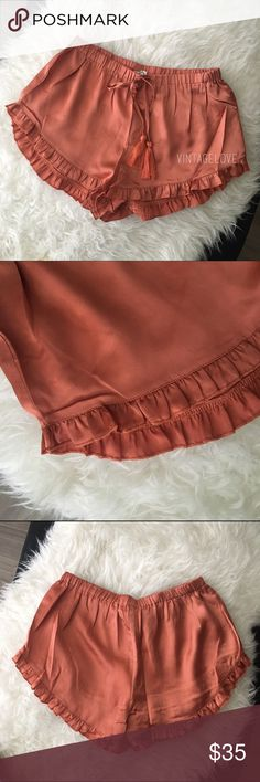ONE DAY SALEBUY1GET1FREE Rose colored satin ruffle shorts with elastic waist and Tassel tie. Shorts